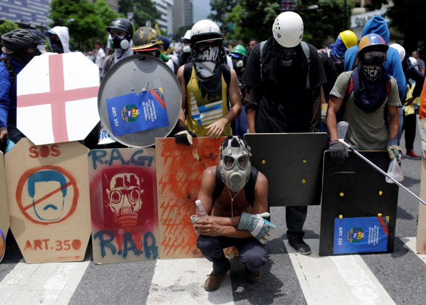 Opposition supporters rally against President Nicolas Maduro in Caracas